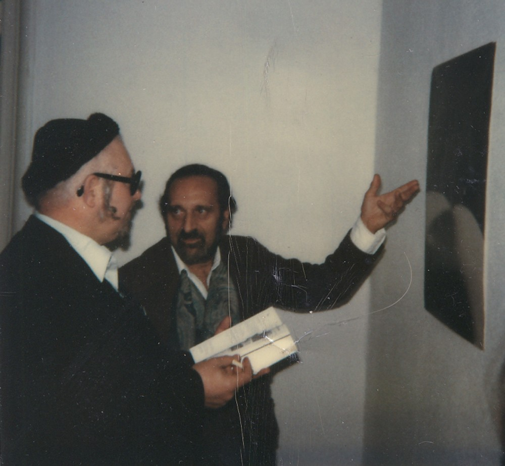 "Solo exhibition at Galeria Ars Viva, Berlin, 1980. Wolf Vostell and Ernesto de Sousa next to the poster ""O Teu Corpo""."