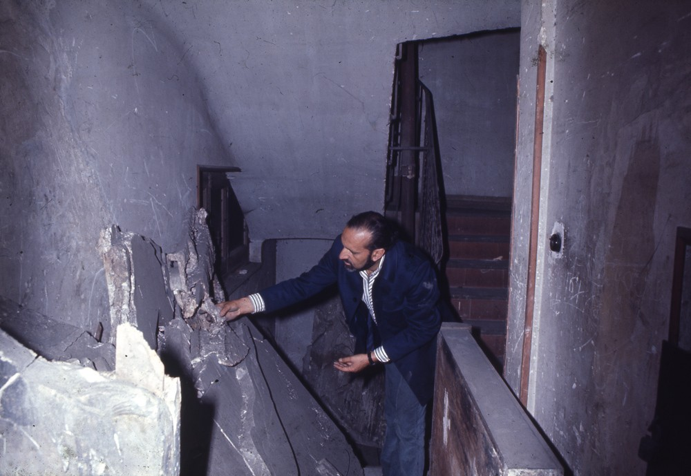 Ernesto de Sousa in the basement of Cine San Carlos with one of Almada Negreiros' panels, Madrid, 1972.